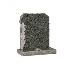 EC68 Green Granite Headstone with rustic edges and hand carved daffodils with natural carved finish.